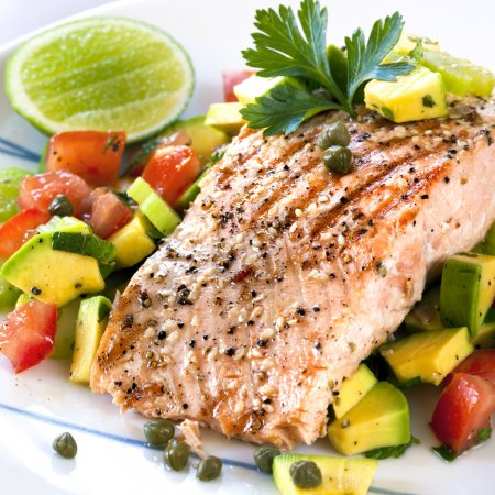 Photo for Grilled Atlantic salmon with an avocado and tomato salsa. Delicious healthy eating. - Royalty Free Image