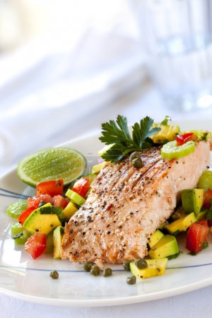 Photo for Atlantic salmon with an avocado and tomato salsa. - Royalty Free Image