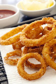 Fried Onion Rings with Ketchup and Lemon