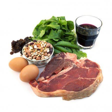 Photo for Food sources of iron, including red meat, eggs, spinach, peas, beans, raisins and prune juice. Isolated on white. - Royalty Free Image