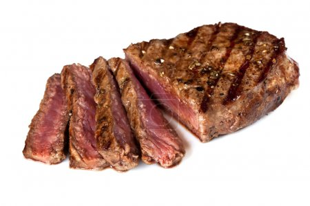 Photo for Grilled beef steak, sliced, isolated on white background. - Royalty Free Image