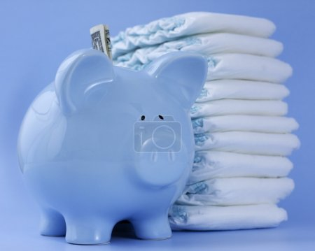 Baby blue piggy bank with diapers on blue