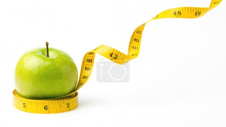 Green apple and leaving centimeters