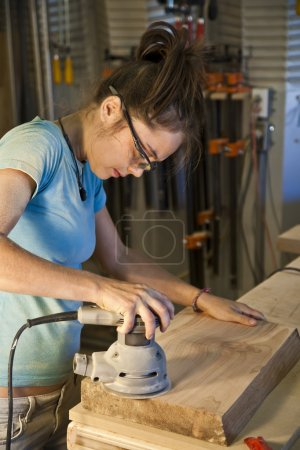 Young woman cabinet making.