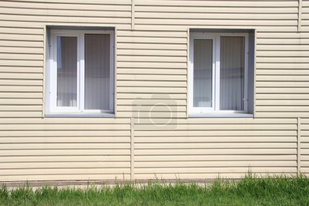 Wall of the house, lined with vinyl siding