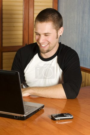 Happy man working on computer