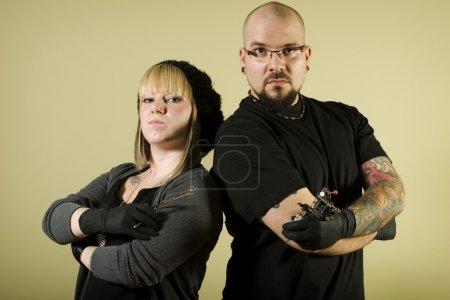 Tattoo shop team looking tough