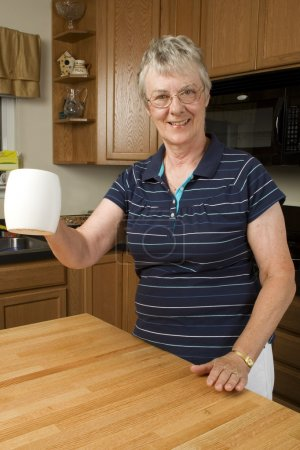 Elderly woman enjoying her morning coffee