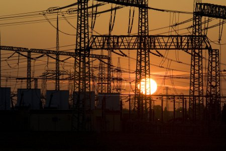 Photo for Solar energy versus electrical energy - sunset and network system of high voltage - Royalty Free Image