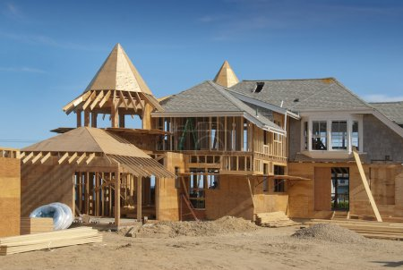 Home addition under construction with plywood stru...