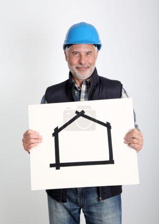 Property developer showing house for sale sign