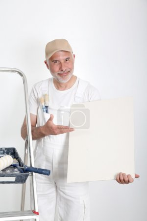 Professional painter showing message board