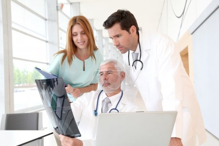 Photo for Medical team checking Xray - Royalty Free Image