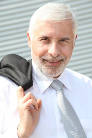 Photo for Portrait of senior businessman standing outdoors - Royalty Free Image