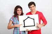 Couple holding whiteboard