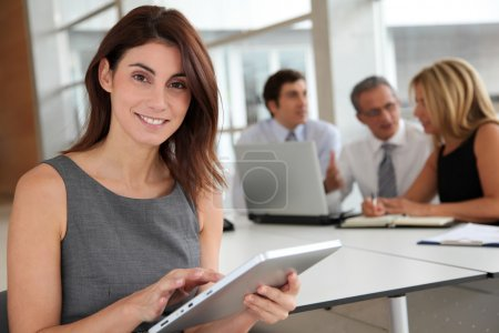 Photo for Executive woman working on electronic tab - Royalty Free Image