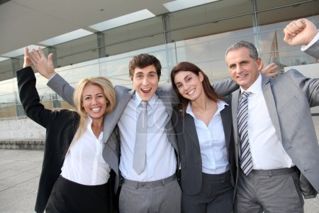 Photo for Group of happy business standing outside - Royalty Free Image