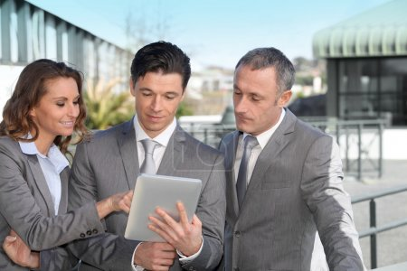 Business partners working on electronic tablet
