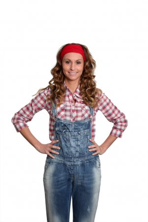 Woman with blue jeans overalls