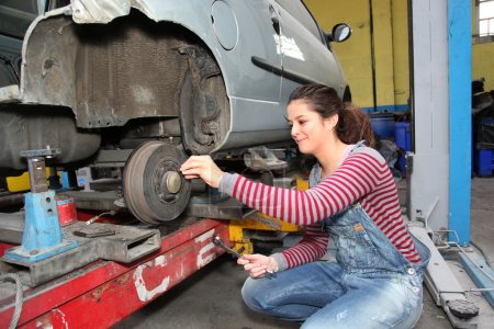 Photo for Teenage girl in mechanical professional training - Royalty Free Image