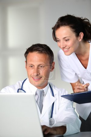 Photo for Doctor and nurse working in the office - Royalty Free Image