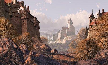 Photo pour Un village médiéval au premier plan avec un château fort au large dans la distance. - image libre de droit