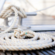 Close-up of a mooring rope with a knotted end tied...