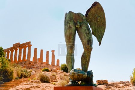 Temple of Juno and bronze statue in Valley of the Temples in Agrigento, Sic