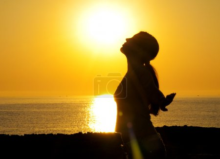Woman silhouette in the sun