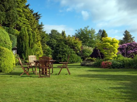 Photo for English garden in summer with furniture - Royalty Free Image