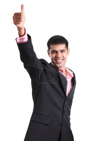 Happy young man in a business suit showing thumb up