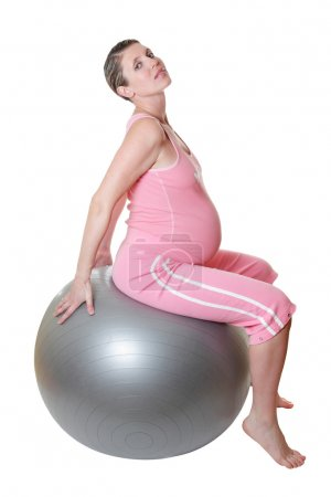 Pregnant woman keeping fit.
