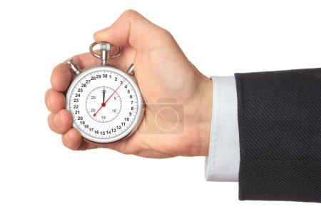 Man's hand holding stopwatch.