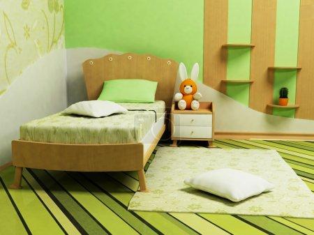 Photo pour Une belle chambre verte pour les enfants avec un canapé, étagères et une table - image libre de droit
