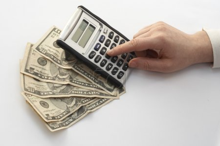 Calculating over a fan of money