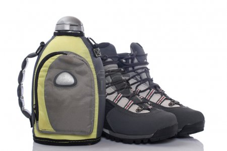 Hiking boots and canteen