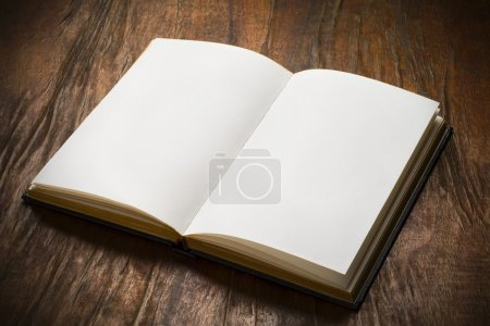Photo for An open book with blank pages on wood table - Royalty Free Image