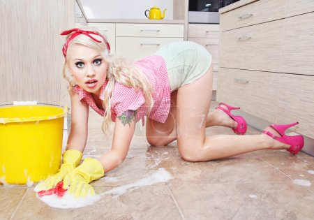 Photo for Sexy housewife doing housework - Royalty Free Image
