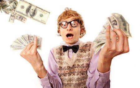 Homme d'affaires drôle avec de l'argent