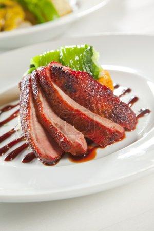 Oven crisp duck breast marinated in a Peking duck style sauce on