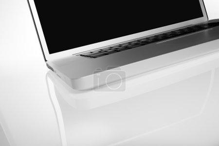 Modern silver laptop on white background