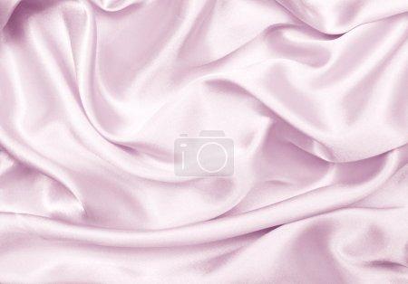 Photo pour Gros plan de tissu doux brillant plissé rose pâle - image libre de droit