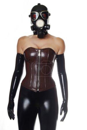 Photo pour Masque à gaz et corset de pvc brun foncé - image libre de droit