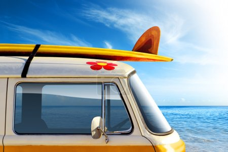 Photo for Detail of a vintage van in the beach, with a surfboard on the roof - Royalty Free Image