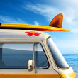Detail of a vintage van in the beach, with a surfb...