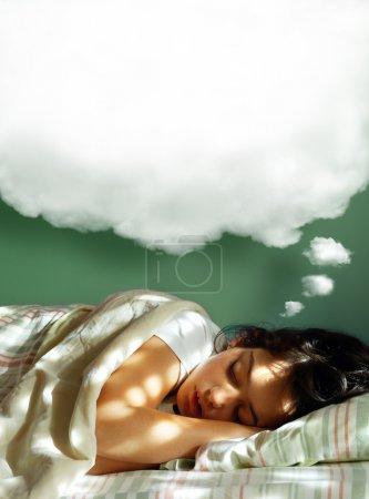 Photo for Young girl sleeping in her bed, with a dreaming fluffy balloon above her head - Royalty Free Image