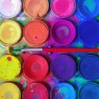 Closeup of messy, used water-color paint-box and p...