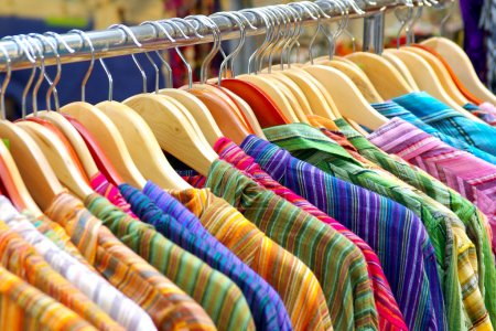 Photo for A rack of colorful shirts hanged for sale at a fair - Royalty Free Image