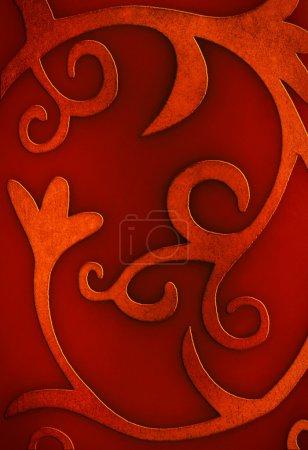 Photo pour Fond rouge de Noël avec des motifs floraux et bouclés - image libre de droit