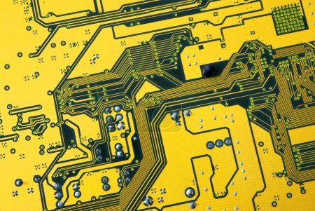 Photo for Photo of integrated circuits of a green and yellow computer board - Royalty Free Image